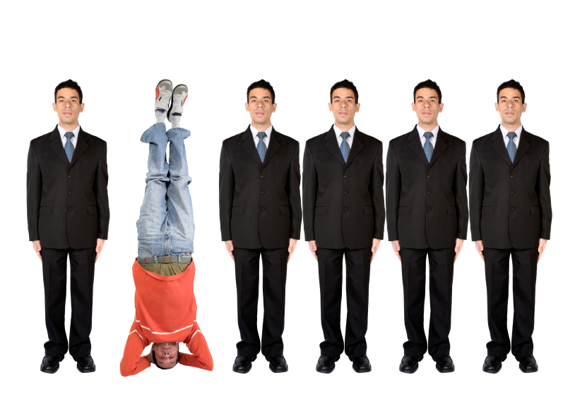 business people in a series with a casual guy doing the headstand
